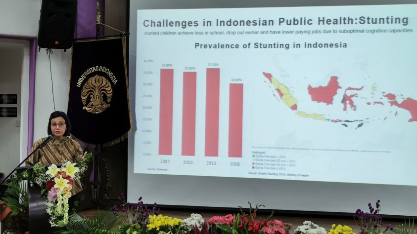 Sri Mulyani delivers a presentation arguing for an increased investment in health, to among other benefits, aid the economy.